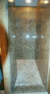 luxury modern walk in shower design feature contemporary clear frame less glass door and chrome wall mounted rain shower faucet and modern glass vanity bathroom pendant lighting ideas beige granite