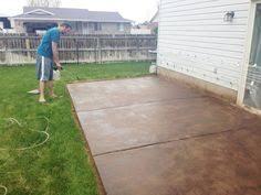 extending a concrete patio how to stain a concrete patio chris loves julia