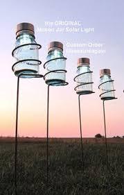 mason jar garden stakes holders with mason jar solar lights the original design by treasureagain httpetsymeucusxr ball mason jar solar lights