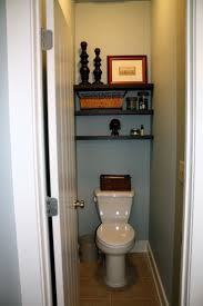 ideas garage bathroom pinterest wood shelves above toilet shelves above the toilet in the master bathr