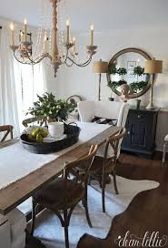 dining room khaki tone: i love the height these lamps from homegoods add to the sideboard and the texture that the shades add to this simple black and white dining room