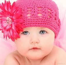cute american baby girl in pink woolen cap baby girl