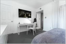 furniture white wooden desk chair grey carpet connected lcd tv wall exciting designs small bedroom attached captivating home office desk