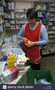 store assistant at work in a pharmacy london uk stock photo stock photo store assistant at work in a pharmacy london uk