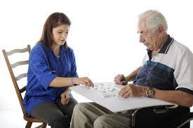 hillcest teen volunteer program hillcrest health services an attractive young volunteer playing dominoes an elderly m