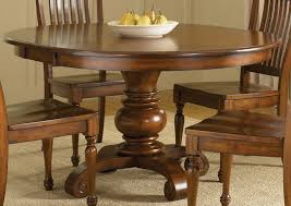 kitchen pedestal dining table set: wooden chairs with round pedestal kitchen table and plate
