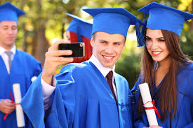 you just graduated from college now what the blog for mr brick graduate students wearing graduation hat and gown outdoors taking a selfie