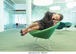 businesswoman napping in office chair stock image business nap office relieve