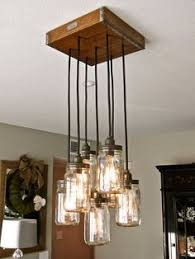 mason jar ceiling fixture these have become the next big thing whats really great about this piece is the dark rustic wood canopy with metal detailing betty 8 light mason jar