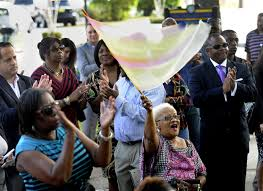 st pete or city will buy african american museum tbo com theresa momma tee lassiter waves a flag and thanks st petersburg or rick kriseman