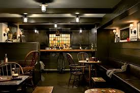 inspired kichler in basement traditional with dark hardwood flooring next to shed bar alongside chocolate brown couch and pub shed basement bar lighting ideas