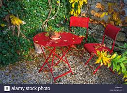patio with red garden furniture in autumn middle franconia bavaria germany autumn furniture
