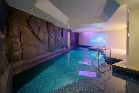 swimming pool then indoor with beautiful lighting pool