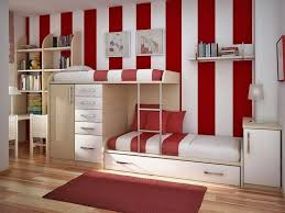 engaging cream wooden bunk beds equipped with white sliding drawer under the and bookshelves mounted on home decor charming bedroom ideas red