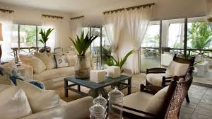 cream couch living room ideas: classic small living room long sheer curtains cream sofas and chairs glass walls small coffee table