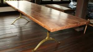 long wood dining table: dining room varnished long solid wood dining table with iron legs above wood floor around