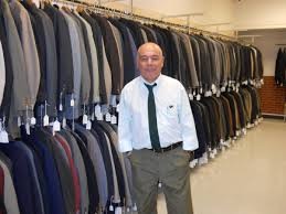 dress for success needs donations of suits and business attire job placement manager nelson fernandini in the men s suits area at career gear san antonio