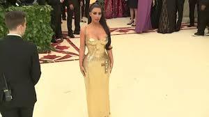 <b>Kim Kardashian</b> goes <b>gold</b> at Met Gala - YouTube