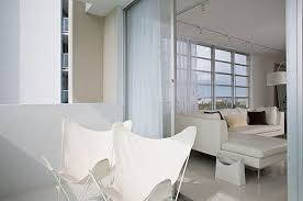 view in gallery modern white chairs on a miami balcony balcony furniture miami