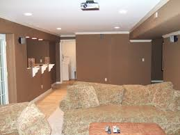 themed family rooms interior home theater: interior design awesome brown theme basement open family room decoration with ceiling projector above floral living