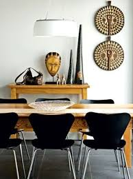 chic ethnic dining room design with ocher colored furniture and african pottery african inspired furniture