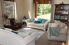 living room in neutrals with turquoise accents brighten dark room
