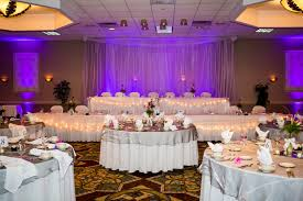 uplighting behind the head table transforms nice into gorgeous beautiful color table uplighting