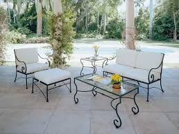 lovely sofa with black iron legs and wihte cushion seat plus matching ottoman and glass rectangle black iron outdoor furniture