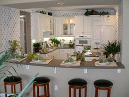 kitchen cabinets home office transitional:   kitchen colors with white cabinets and black appliances
