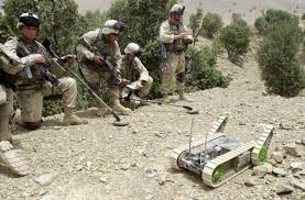 photo essay years of war warrior scout land mine detectors stand by as a us army ier right maneuvers hermes the robot into a cave to detect mines traps and other unexploded ordnance as