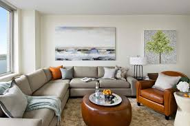 chic large wall decorations living room: living roomliving room with large wall art also grey sofa and brown armchair