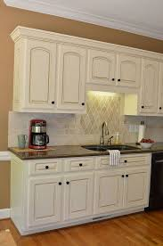 painted kitchen cabinets vintage cream: painted kitchen cabinet detailssherwin wms cashmere antique white with valspar glaze