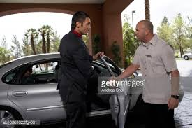 hotel porter shaking hands with business man outside car side view stock photo porter dealership