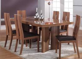 modern wood dining room sets: black wooden dining chairs for rectangular dining table