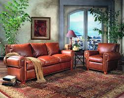 red sofas leather rug