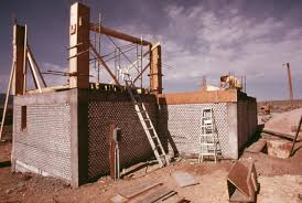 new mexico home decor: tin can wall wikipedia the free encyclopedia a building being built using beer cans as bricks home decor