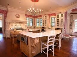 large white kitchen with red and white wallpaper this kitchen contains 2 large islands spacious eat kitchen