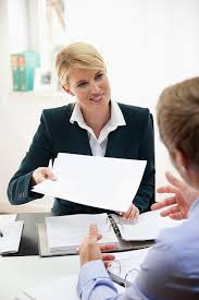 best keywords to use in your job search young businessw giving paperwork to colleague in office