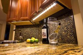 snake scales inspired kitchen backsplash combined with led strips under cabinet lighting cabinet lighting backsplash