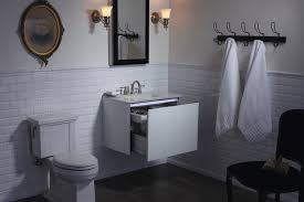 traditional style antique white bathroom: note white cabinets tan counter white sink white door vintage off white bathroom design tsc