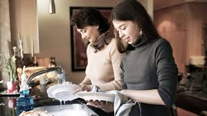 what job is right for your teen adhd or learning disabilities teen girl washing dishes her mother in the kitchen