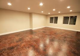 finished basement stained concrete floor decorated art studio best lighting for art studio