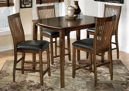 4 chair kitchen table: stuman counter height dining table w  chairssignature design by ashley