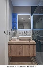 washstand bathroom pine: interior view of a modern bathroom in foreground the counter top washbasin and wood furniture