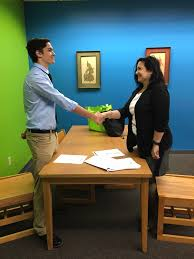 career technical education cte conduct a mock job interview pictured above gina lostracco of fifth third bank conducts mock interviews lely high school academy of information technology students to help them
