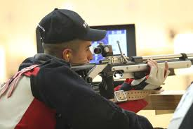 u s department of defense photo essay marine corps sgt jorge toledo fires his air rifle during the permanent disability shooting competition