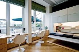 view in gallery beautiful shelves and lighting accentuate the appeal of the murphy bed unit beautiful murphy bed desk