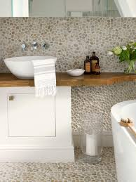 the pebble tiles in this spa bathroom blog spa bathroom