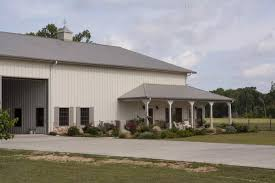 Perfect Combo  Metal Building Home  amp  Metal Barn Building      The path leading to the barn and garage  Windows located inside the big doorway enables