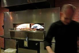 vellos brickstreet grill savor gainesville kitchen manager shawn jones prepares meals for patrons at vellos brickstreet grill